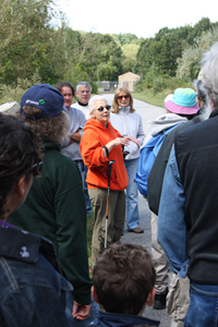 Marge Fisher talks to crowd at September 18 walk
