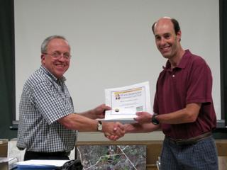 WCLT president John Metzger congratulates Bruce Tretter